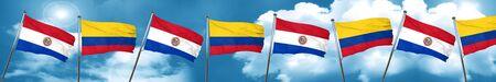 bandera de paraguay: Bandera de Paraguay con la bandera de Colombia, representación 3D Foto de archivo