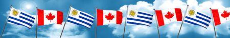 bandera de uruguay: Bandera de Uruguay con la bandera de Canadá, representación 3D Foto de archivo
