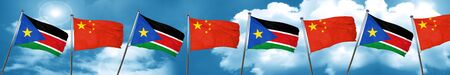 south sudan flag with China flag, 3D rendering