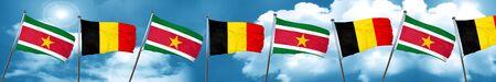 Suriname flag with Belgium flag, 3D rendering Foto de archivo