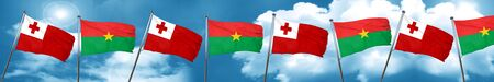 Tonga flag with Burkina Faso flag, 3D rendering