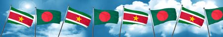 Suriname flag with Bangladesh flag, 3D rendering