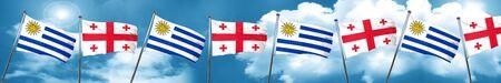 georgian: Uruguay flag with Georgia flag, 3D rendering