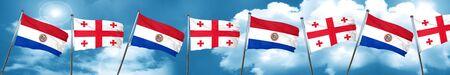 bandera de paraguay: Paraguay flag with Georgia flag, 3D rendering Foto de archivo