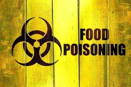 poisoning: Vintage Food poisoning on a grunge wooden panel