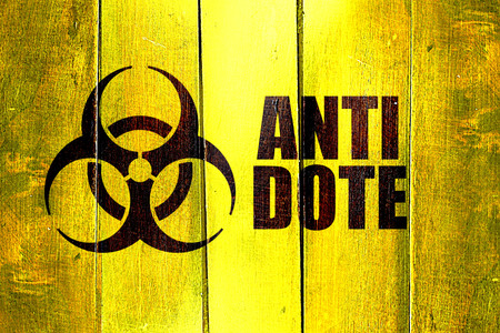 antidote: Vintage Antidote on a grunge wooden panel Stock Photo