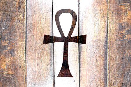 ankh cross: Vintage ankh symbol on a grunge wooden panel