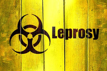 lepra: Vintage Leprosy on a grunge wooden panel