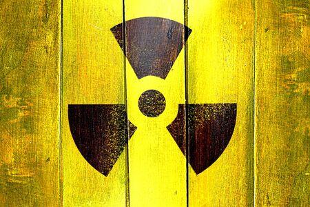 Vintage Radiation warning on a grunge wooden panel Stock Photo