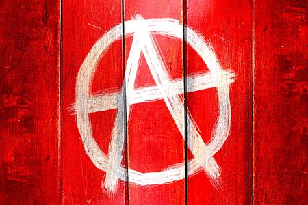 Vintage Anarchist sign on a grunge wooden panel Stock Photo
