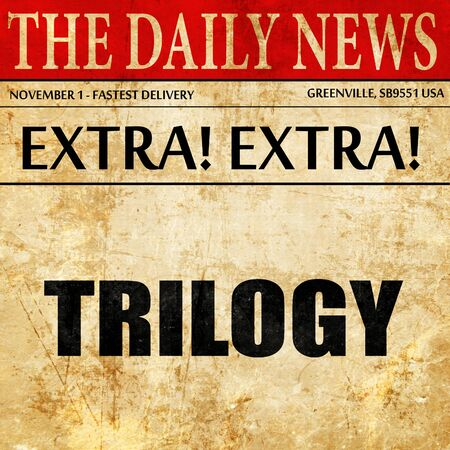 trilogy: trilogy, article text in newspaper Stock Photo