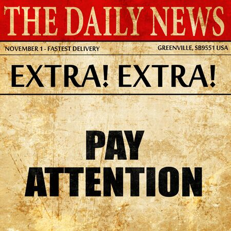 prestar atencion: pay attention, article text in newspaper Foto de archivo