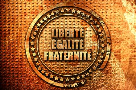 fraternidad: French text liberte egalite fraternite on grunge metal backgro