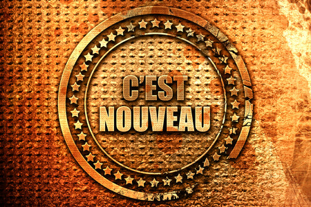 rende: French text c est nouveau on grunge metal background, 3D rende Stock Photo