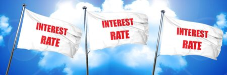 borrowing: Roadsign of higher interest rates ahead against blue sky, 3D rendering, triple flags