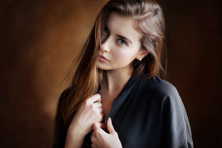 Beautiful young female brunette model in shirt