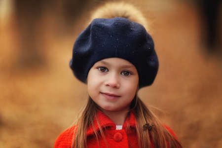 Outdoor autumn portrait of young girl