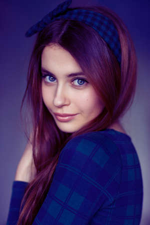 Beautiful young female model as school girl