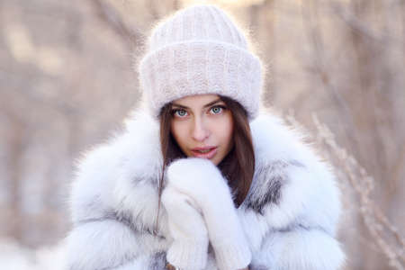 Young woman standing outside in winter Banco de Imagens