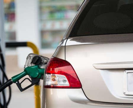 refilling: Gas pump refilling automobile fuel