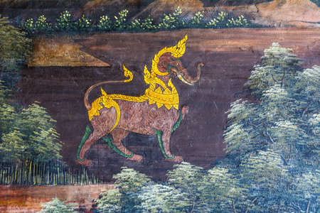 Traditional Thai mural painting on temple wall at Wat Pra keaw in Bangkok, Thailand
