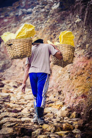 worker for sulfur mining industry in KAWAH IJEN VOLCANO, EAST JAVA, INDONESIA