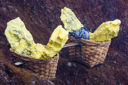 sulfur mining industry in KAWAH IJEN VOLCANO, EAST JAVA, INDONESIA  photo