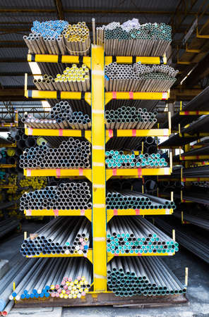 round rods:  Steel pipes storage in warehouse Stock Photo