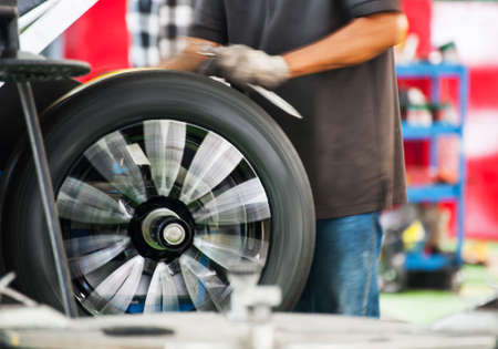 Inside a garage - changing wheels-tires during rotation Stock Photo
