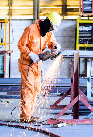 construction plant: Electric wheel grinding on steel structure construction plant Stock Photo