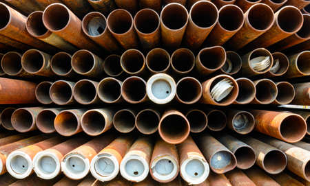 Part of rusty old pipes stacked up with natural light photo