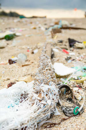 Garbage  waste  on the beach Imagens