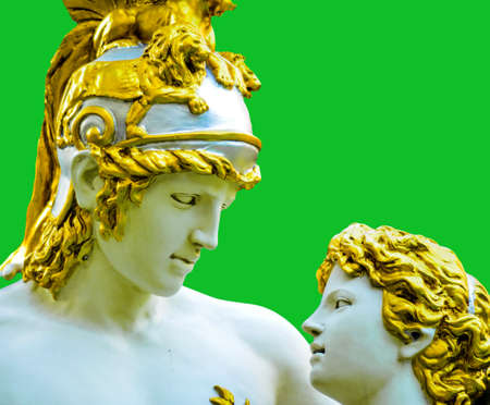 Ancient roman man and women statue in the garden park in green background photo