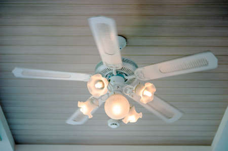 Vintage ceiling fan and lamp fixture in hotel photo