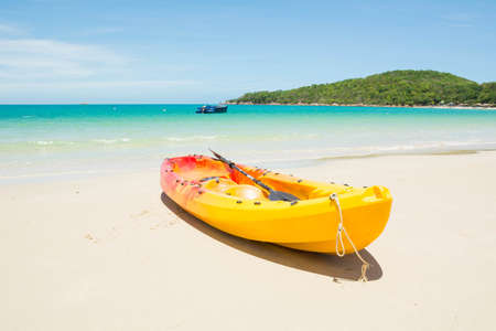 koh samet: Yellow kayaks on the beach. Samet island,THAILAND