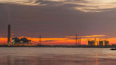 gas refinery: panorama on power plant and natural petroleum gas refinery plant area at twilight
