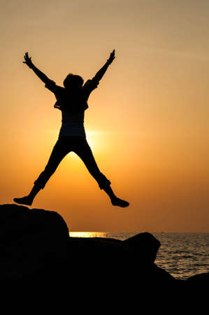 successful woman: Successful woman jumping, dancing and having fun on sunset in beach. Freedom and happiness concept. Girl celebrating work out success.