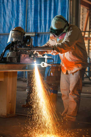 plasma cutting process of metal material with spark photo
