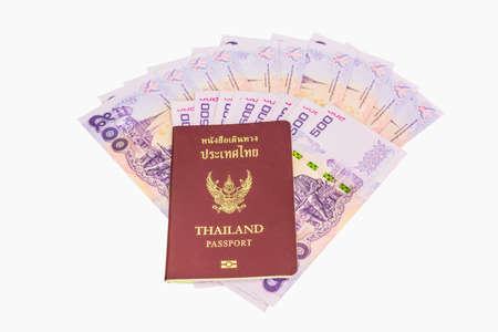 Thailand passport and Thai money. Concept of traveling. photo