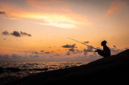 fishingpole: Fisherman on sunset Stock Photo