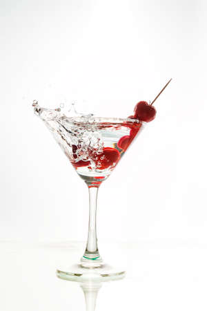 Cocktail with splash and on white background