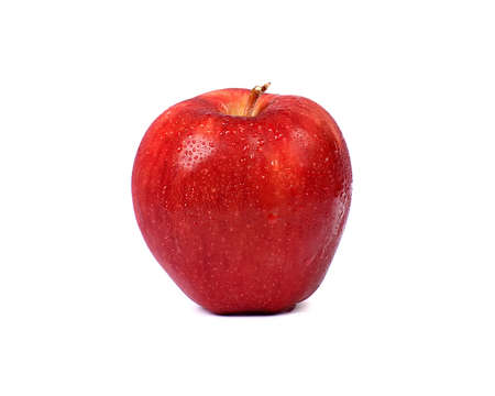 Ripe red apple with water drop on a white background.