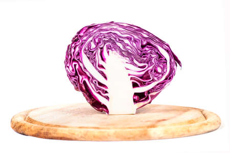 Chopped Red Cabbage on Wooden Cutting Board on white