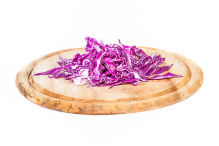 Closeup of Chopped Red Cabbage on Wooden Cutting Board on white background