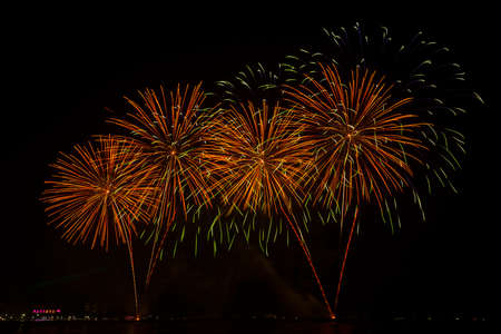 firework display: Beautiful firework display for celebration over the sea Stock Photo