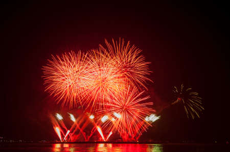 Beautiful firework display for celebration over the sea Imagens