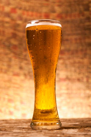 Glass of beer with brown blackground