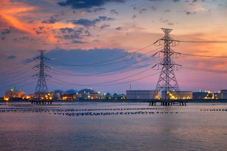 Electric towers and refinary oil storage plant