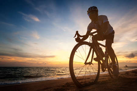 cycling concept outdoors against sunset