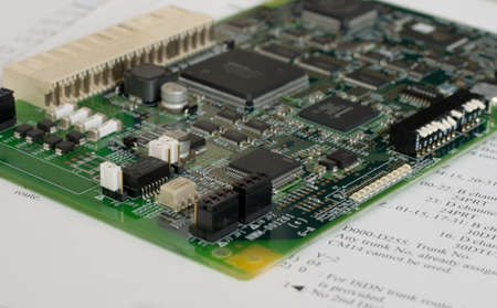 miniaturization: Printed circuit board over technical documentation (close-up photo) Stock Photo